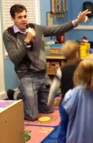 Joe performs for the children.